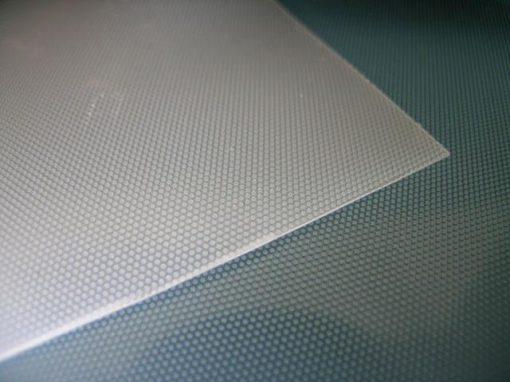 Sistema adesivo non permanente